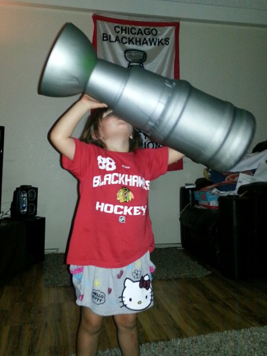 Our homemade Stanley Cup being lifted by our little Kittyhawk