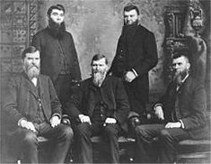 Peter and Jacob Studebaker standing Clem, Henry and John M seated