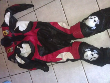 Full race leathers with after market knee pucks / sliders.