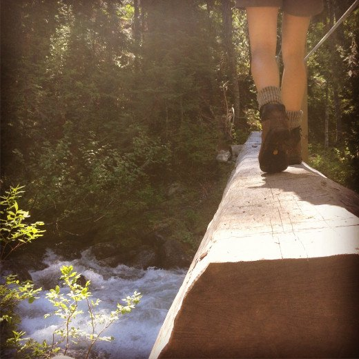 Crossing a bridge on the hike to Hanging Lake near Whistler, BC.