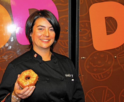 Chef Heidi Curry is seen at Dunkin Donuts about to enjoy a doughnut.