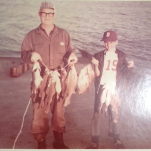 Steve and (who IS that little boy) with a nice string of White Bass.