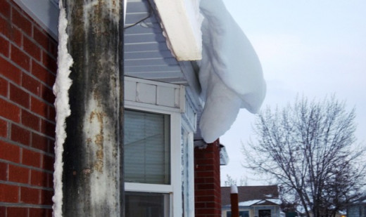 This photo by Nancy Owens shows deep snow drifts hanging from the house roof.