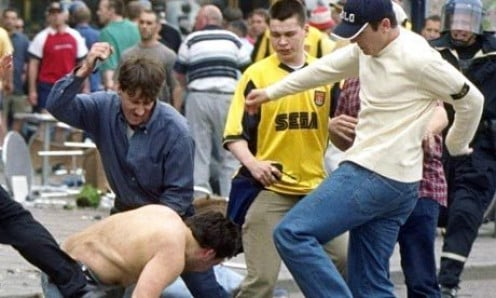 Fighting with fans who support the opposing team is what unruly fans do.