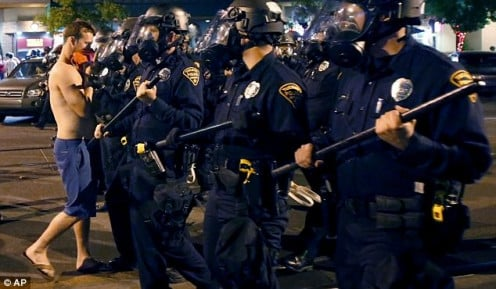 Riot squads had to be called to Tuscson to defuse a riot because Arizona had lost a major championship game.