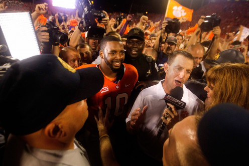 Dabo Swinney, head coach, Clemson Tigers finds it tough to talk to reporters after they upset their rivals at FSU, for their fans rushing the field and trying to get into the photo.