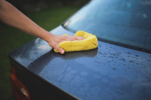 Hand washing a car.
