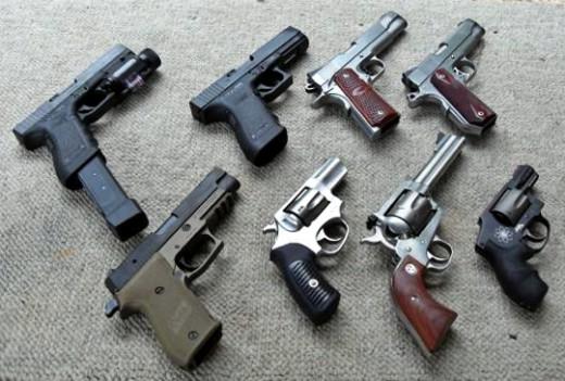 Clockwise from top left: Glock G22, Glock G21, Kimber Custom Raptor, Dan Wesson Commander, Smith & Wesson .357, Ruger Blackhawk .357, Ruger SP101, Sig Sauer P220 Combat.