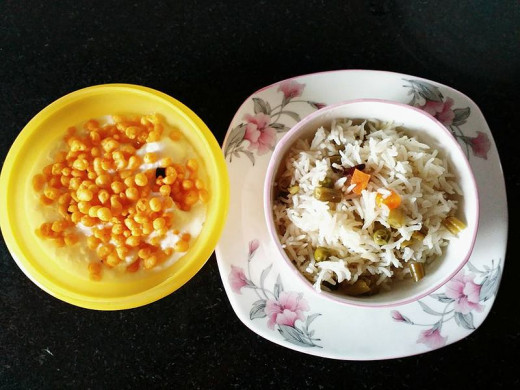 Vegetable Pulao served with boondi raita