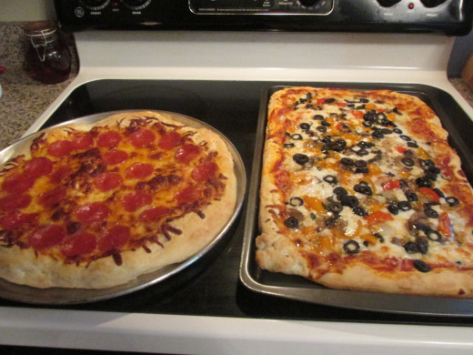 The round one has just cheese and pepperoni and the square one has sauce, cheese and veggies.