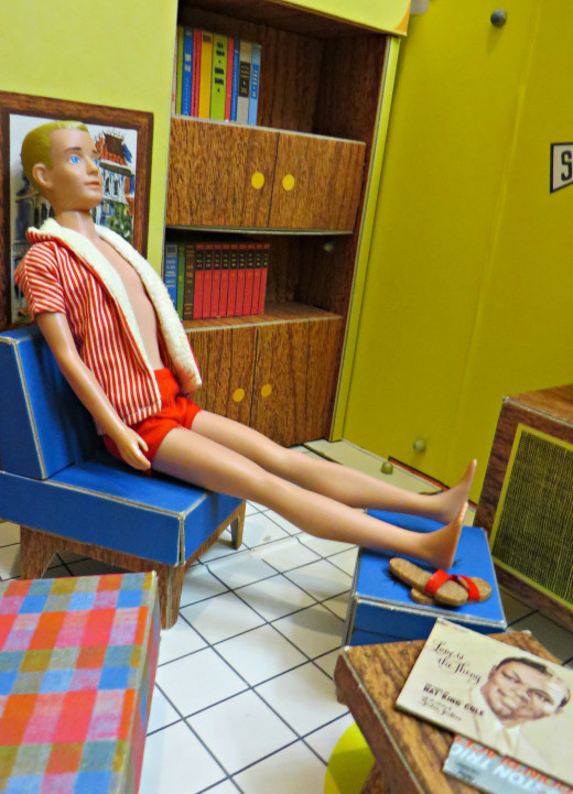 Ken is resting and relaxing in his favorite blue chair in the 1962 Barbie Dream House made in the USA in California by Mattel.