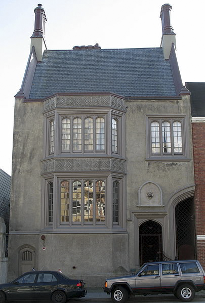 The building boldly represents Gothic Tudor Revival architecture.