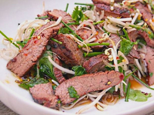 Grilled flank steak can be tender and full of flavor if it is marinated, seared and sliced thinly across the grain. Ideal for meal with salad and vegetable dishes. See many fabulous recipes to try.