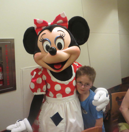 Okay, I'll pose with Minnie.