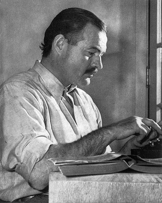 Ernest Hemmingway at his desk