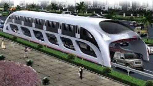 The Straddling or 3D Coach Bus stands almost 14 feet tall and it takes of two lanes.
