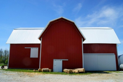 This is a recent photo of the barn on the farm where I grew up.  As you can see, aluminum siding now covers the old, vertical, wood siding.