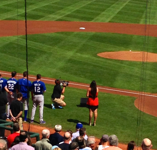 I'm one of the bald guys on the third base side, right behind the woman who was singing the National Anthem.