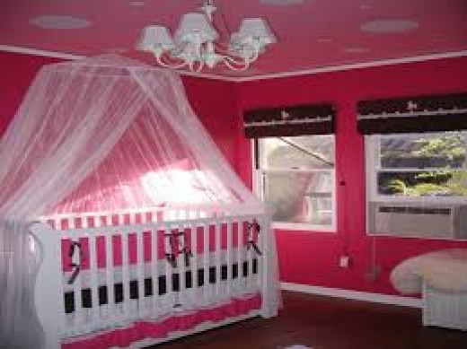 A mosquito net is a must for baby and there are a number of ways to put it into the room without it looking ugly.
