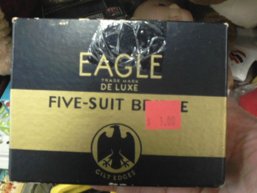 "I assume that the sticker is covering up part of the phrase ""Five-Suit Bridge."" Never heard of it. What could the fifth suit be? Is it like The Fifth Element? I am intrigued."