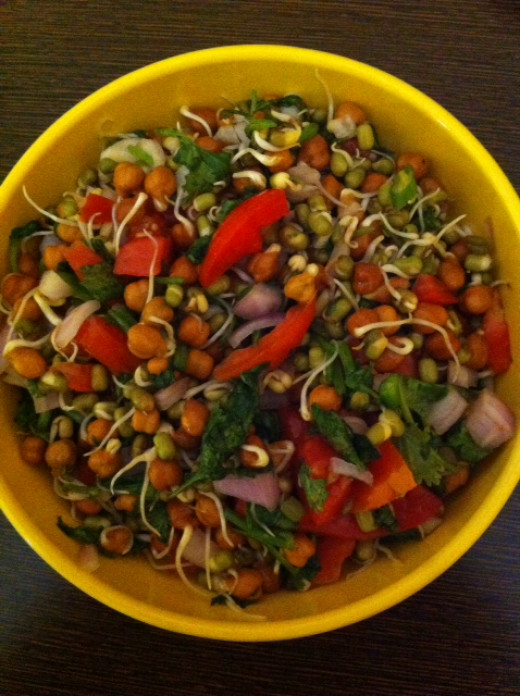 Moong/ Chana Sprouts with finely chopped onion, tomato, green coriander and lime juice---Loaded with Nutrition and yummy too