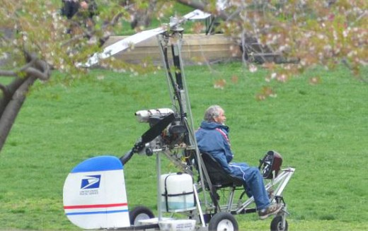 Humble Mailman Doug Hughes  parks his Gyrocopter on the Capitol lawn, meekly waits to go about making his delivery to Congress.