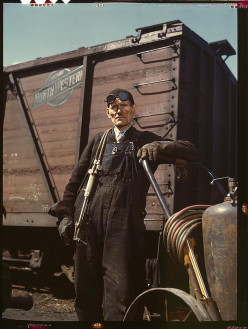 Mike Nichols, an employee of one of the Proviso Company, working the rip yard in outer Chicago.