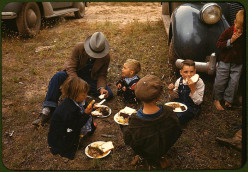 Homesteaders gather for a meal of free barbecue at a local get-together.