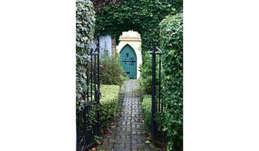 Gateway and path leading to a door