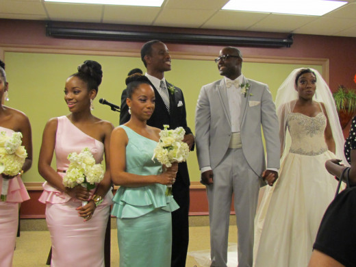 The bridal party form a receiving line after the wedding ceremony.
