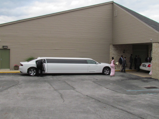 One of the stretch limos provided for the bride and groom in front of the Kingdom Hall.