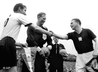 Fritz Walter (left) and Ferenc Puskás (right) shake hands before the final of the 1954 World Cup