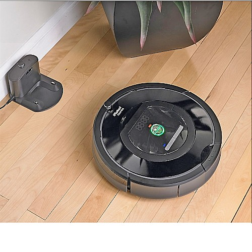 Roomba getting ready to dock on the charging station.