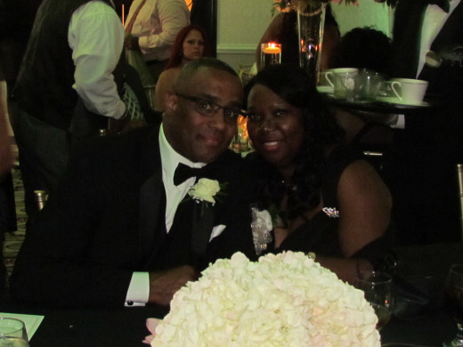 The father of the groom Robert Bey with his beautiful wife, Ollie Bey.