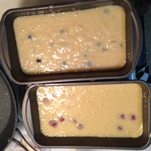 The batters for the raspberry and blueberry breads before going in the oven. Sadly, most of those berries are going to sink as the bread bakes.