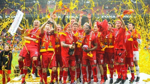 Players from FC Nordsjaelland celebrate after defeating Horsens 3-0 on May 23, 2012 to clinch the Danish Superliga for the first time ever.