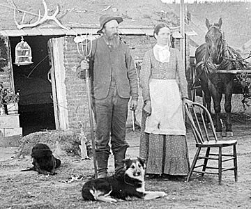 "A typical homesteading family seen in their ""every day clothes."""