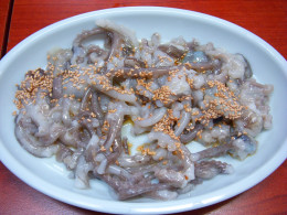 A plate of sannakji. Live octopus seasoned with sesame oil and topped with sesame seeds.