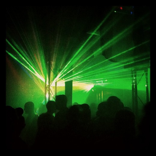 Green laser light show at a Sydney dance party