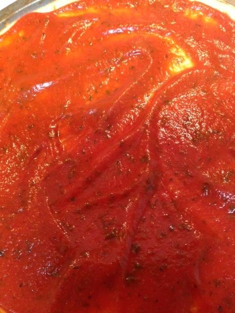 Spread Pizza sauce on Pizza Crust
