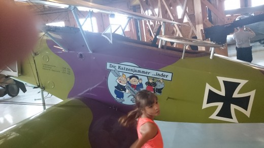 Kathy and one of the planes inside the German hanger.