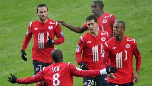 Players come to congratulate Moussa Sow (8) after scoring a hat trick against Lorient on Dec. 5, 2010. The 6-3 victory for Lille was the highest scoring match of the 2010-11 Ligue One Season
