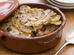 Lancashire hotpot made traditionally from lamb or mutton and onion, topped with sliced potatoes, left to bake in the oven all day in a heavy pot and on a low heat.