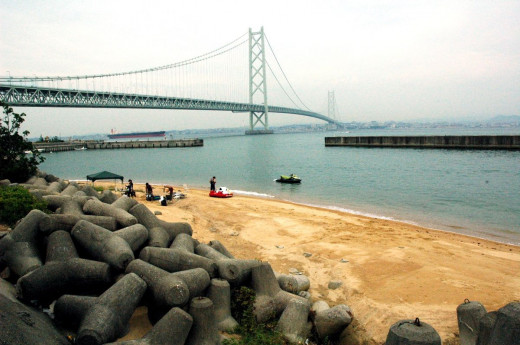 View of Akashi Bridge from beach on Awaji Island Hyogo Japan