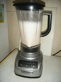Done blending and ready to pour out and strain the Almond Milk.