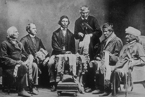 Iroquois Chiefs from the Six Nations Reserve reading Wampum belts in 1871.