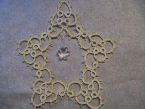 Heavily starched Star ornament with hanging crystal snowflake (I tatted this in the 1980s).