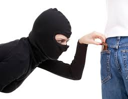 This pickpocket thinks that if he looks like a Ninja, no one will be able to identify him.