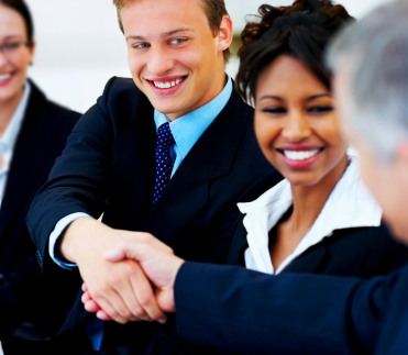 Handshaking team member or employees symbolizing that there's no more dispute between them.