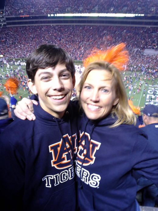 Fans in Alabama are born and raised with an intense allegiance. My family includes five generations of Auburn fans. This is me with my son, Bo, at the 2013 Iron Bowl at Auburn's Jordan-Hare Stadium. My daughter, Shelby, was in the student section.